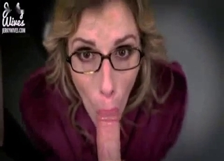 Glasses-wearing blonde MILF strokes son's cock