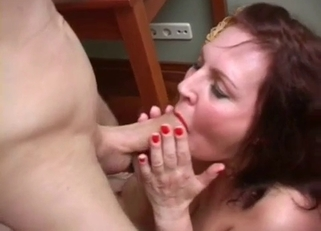 Red get-up redheaded MILF sucking son's cock