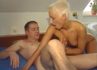 Short-haired blonde fucking her dad on a bed