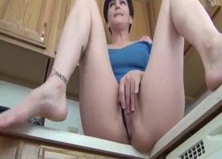 Short-haired mommy giving upskirt shots