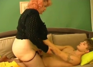 Chubby redhead strokes her son's massive cock