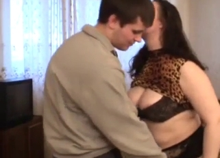 Wavy-haired and fat MILF fucking her son