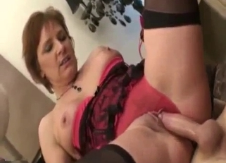Corset-clad MILF rides her son's huge cock