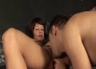 Dark-haired beauty sucking her hung son's cock