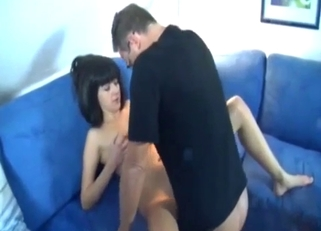 Skinny brunette riding dad's huge cock on a couch