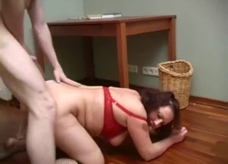 Wavy-haired MILF in red fucking her young son