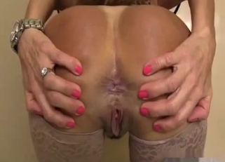 Stockings-clad MILF shows her gaping fucking holes